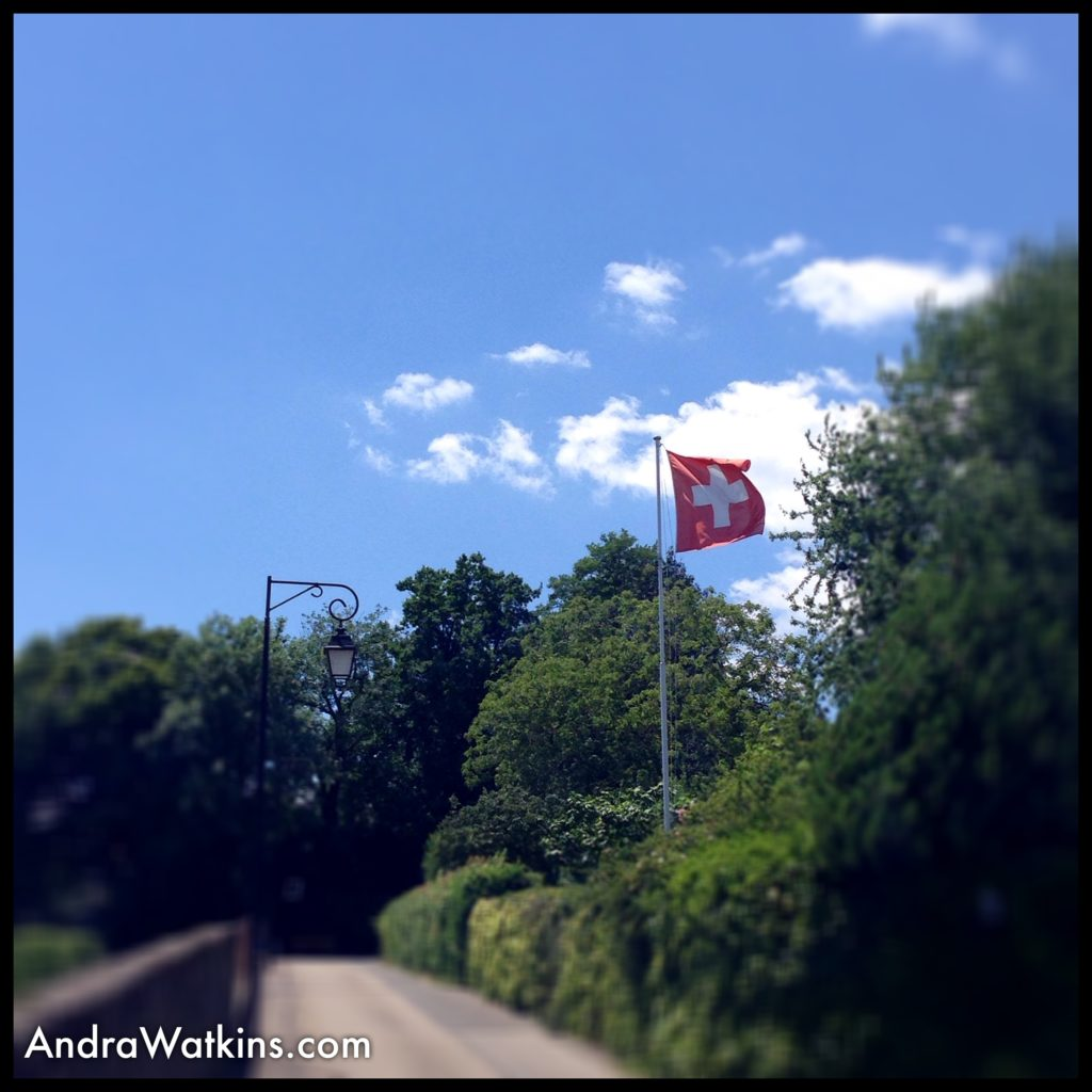 swiss flag on way from nyon to gland, switzerland