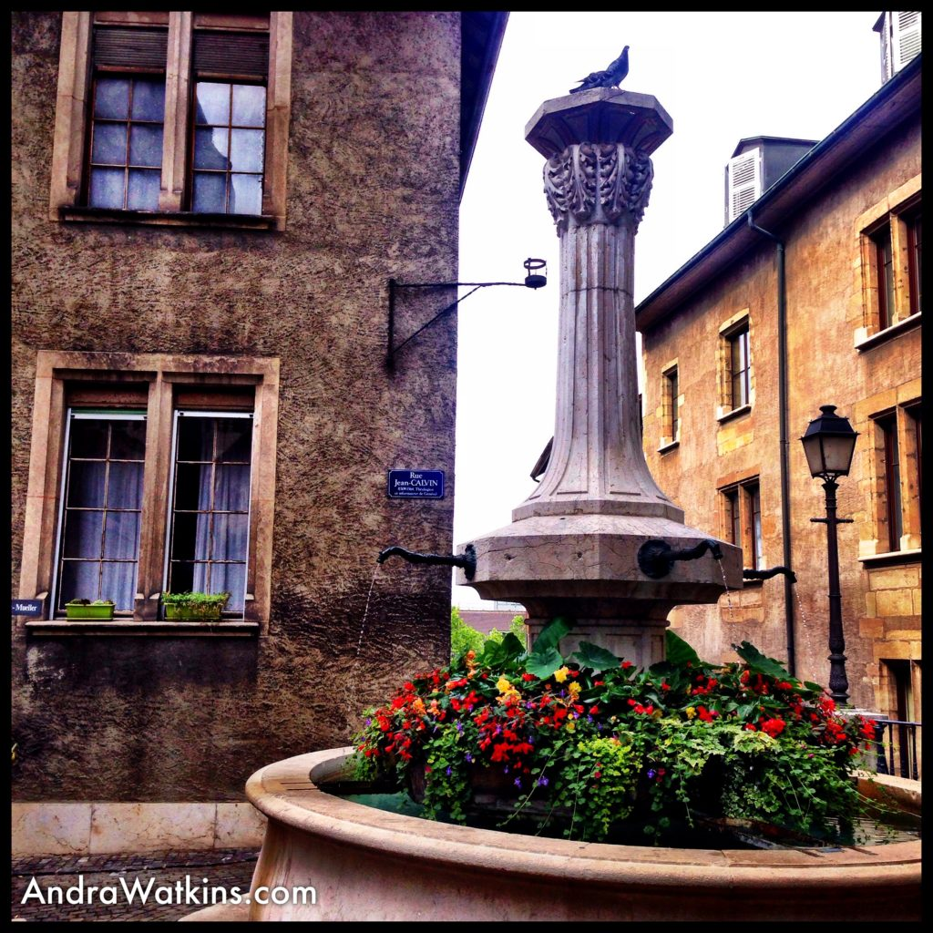 John Calvin lived in the house on the left, but I was taken with the fountains spangled with flowers around the old city.